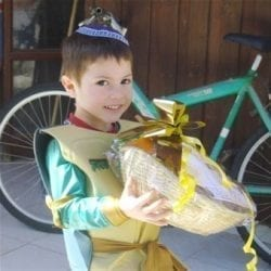 Boy receiving Purim treats in Israel