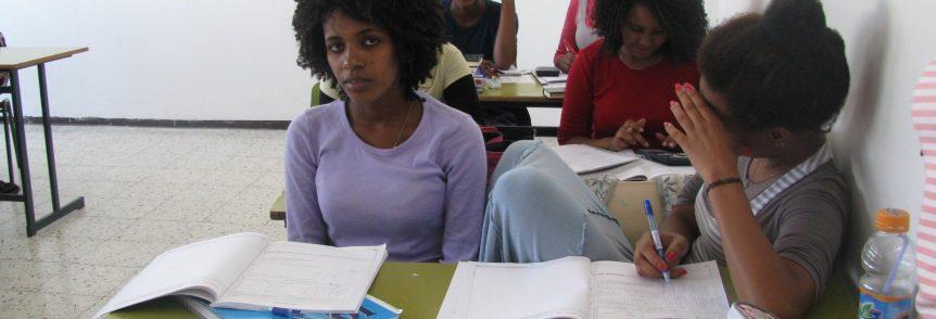 Ethiopian girls sitting at a desk