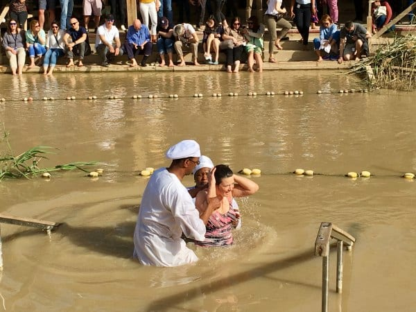 CFOIC tour baptism in the Jordan River