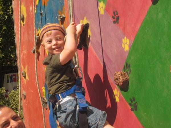 A boy with Down Syndrome gets to go rock climbing at a Heart of Benjamin Passover Camp