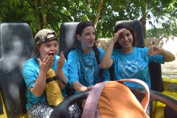 Riding a roller coaster during a Passover Camp with Heart of Benjamin child and volunteers